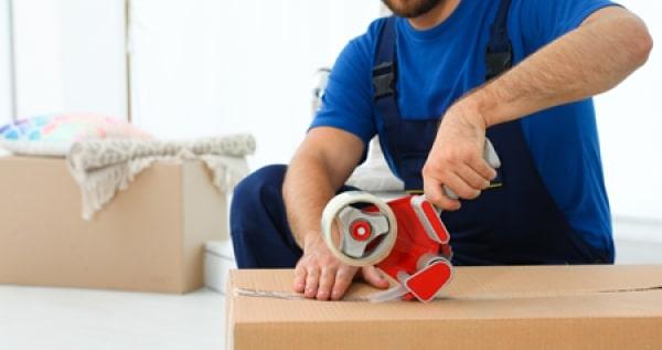 Man packing cardboard box